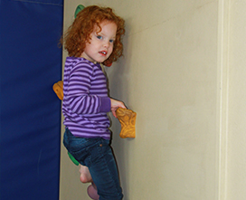Girl climbing a climbing wall